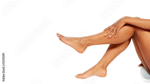 Beautiful female legs isolated over white background.Beauty and