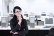 Asian businesswoman thinking at office