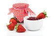 Strawberry berries and a jar of jam isolated on white background