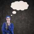 Asian female muslim thinking with blank cloud