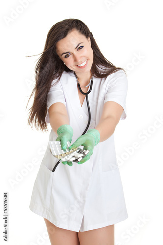 woman doctor with pills in hand.  Female doctor holding many pil