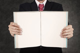 Close-up businessman hold blank book