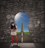 Happy female student and success road view from keyhole