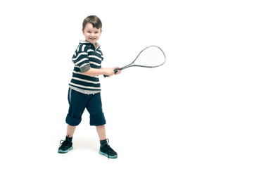 Little boy with tennis racket