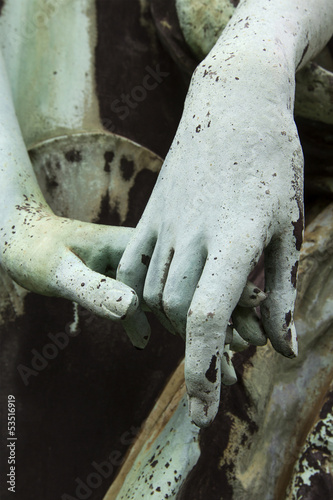 old bronze statue two people holding hands
