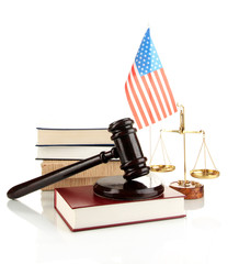 Wooden gavel, golden scales of justice, books and American flag