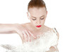 Beautiful  girl with a white feather. Spy beauty skin treatment.