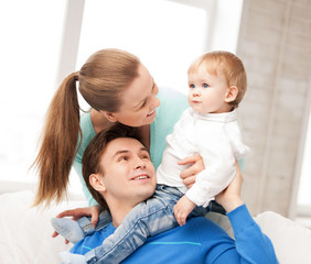 happy parents playing with adorable baby
