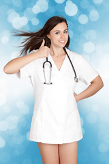 attractive female doctor woman show thumbs up hand sign