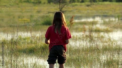 boy on a flooded meadow, swamp boy explores