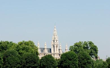 Vienna City Hall beyond the trees in Heldenplatz, Austria