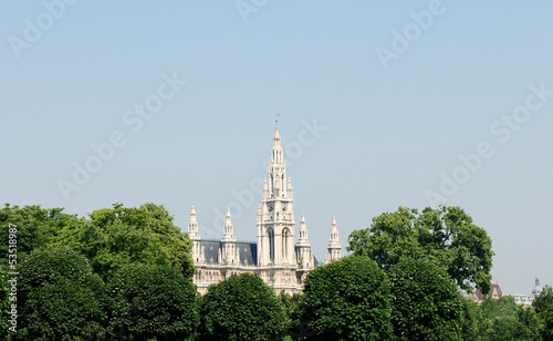 Vienna City Hall beyond the trees in Heldenplatz, Austria