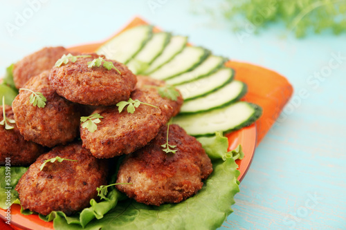 cutlets with cucumber and watercress