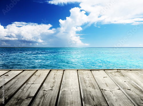 Sticker Caribbean sea and wooden platform
