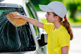 Carwash - young girl helping in carwash