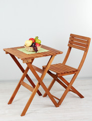 Wooden table with fruit in room