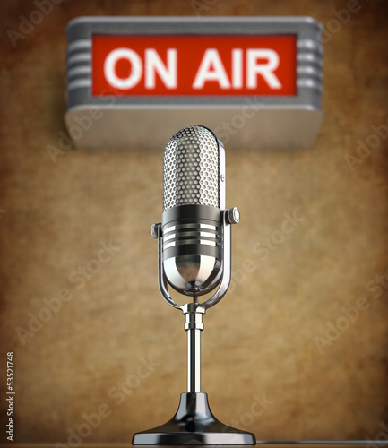 Retro microphone in the old studio with on air sign