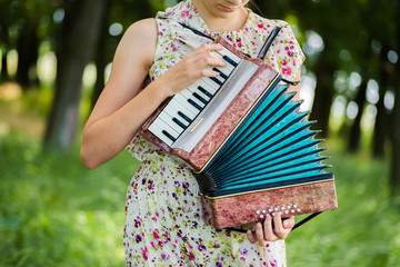 woman playing the accordion