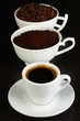 Different types of coffee in three cups on wooden table