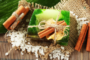Hand-made soap, sea salt and leaf on grey bamboo mat