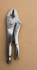 locking pliers wood background