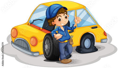 A male mechanic fixing the yellow car