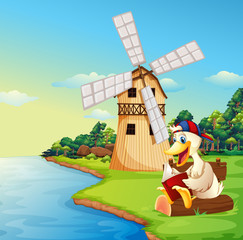 A duck reading a book near the windmill