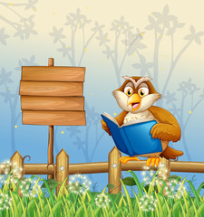 An owl reading a book beside a wooden signboard