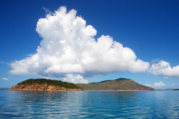 White cloud hovering over island