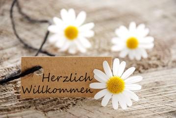 natural looking label with herzlich willkommen