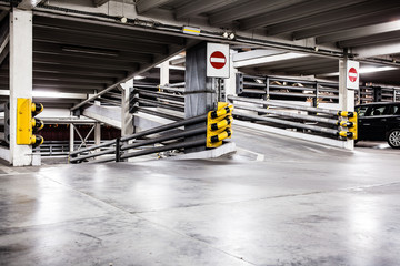 Parking garage interior and cars