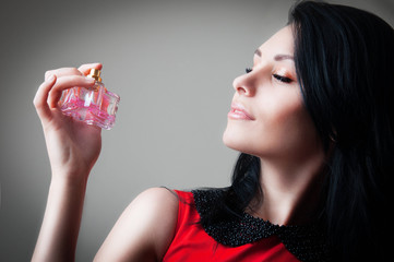 woman with a bottle of perfume
