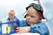 Постер, плакат: Малыш ученый Ребенок в спецодежде занимается опытами