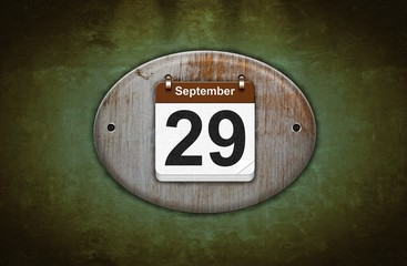 Old wooden calendar with September 29.