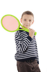 Boy with a tennis racket on white background