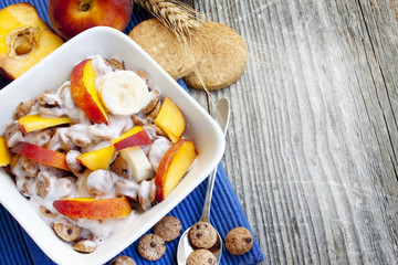 Breakfast bowl with cereals and peaches