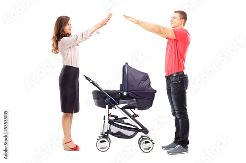 Mother and father gesturing with their hands protection
