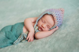 Newborn Baby Girl Wearing a Pixie Hat