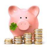 Piggy bank with clover and coin stacks