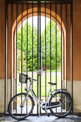 Bicycle against metal gate