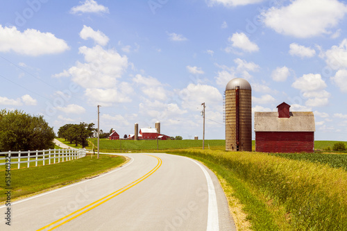 Countryside Road With Old Barn And Big Farm