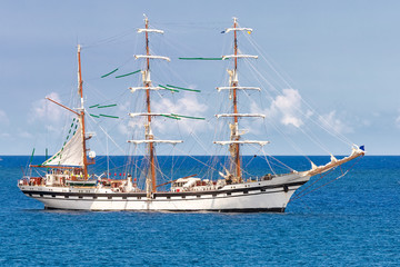 Sailing ship on a calm blue sea