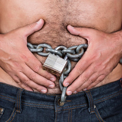 Man with a chain and padlock around his stomach
