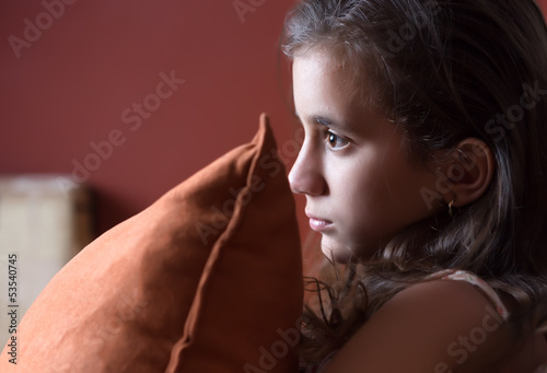 Girl watching television late at night
