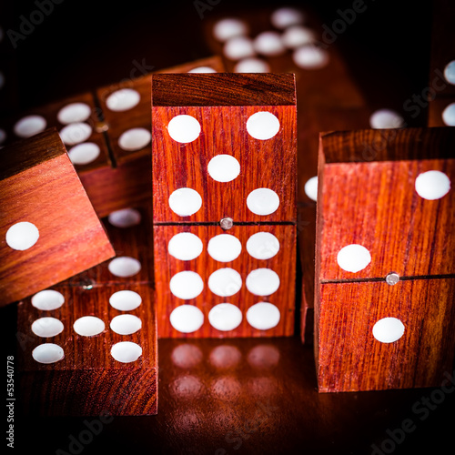 Game of dominoes with a dark background and reflections