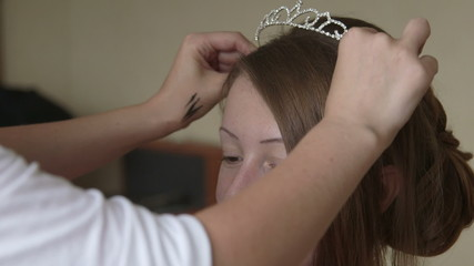 Putting on wedding tiara