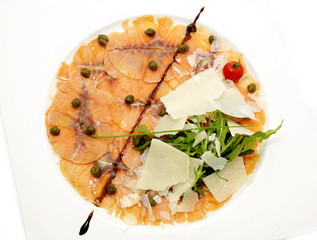 carpaccio of salmon on a table in a restaurant