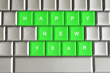 Happy New Year  spelled on a metallic keyboard