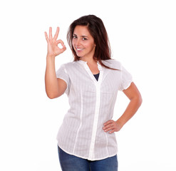 Young hispanic young woman gesturing ok sign