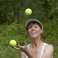 Woman juggling tennis balls